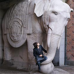 Me setting on a elephant's statue's trunk